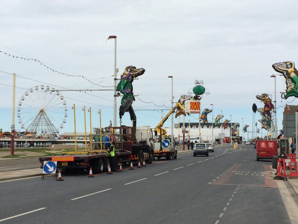 Installing the Illuminations on Blackpool promenade which are made at Lightworks