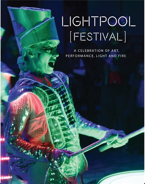 Spark! Illuminated drummers performing at LightPool Festival